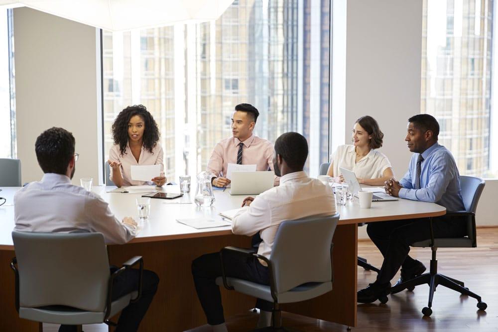 people sitting board room table